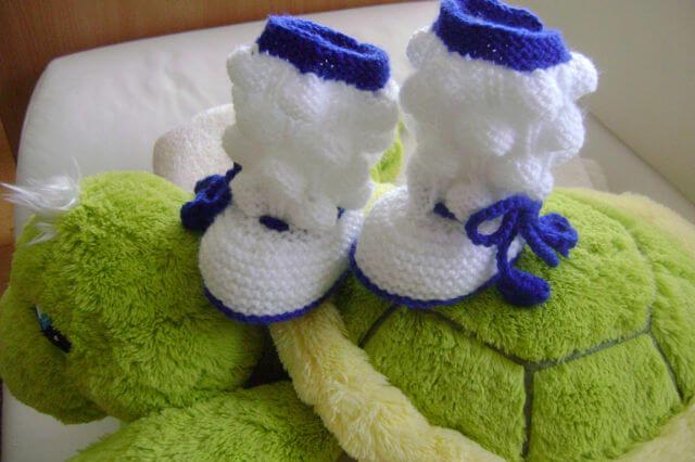 Фото пример пинеток для новорожденных спицами